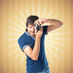 Man photographing over pop background