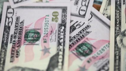 dollar bills are moving