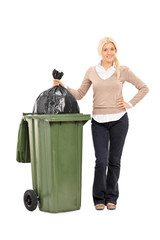Young woman throwing out the trash
