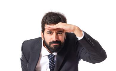 Businessman showing something over white background