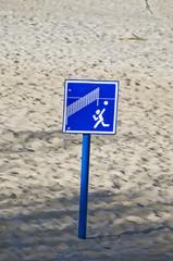 volleyball  sign on beach resort sand near sea