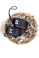 Wireless Flash Trigger and shredded paper in basket , Isolate on