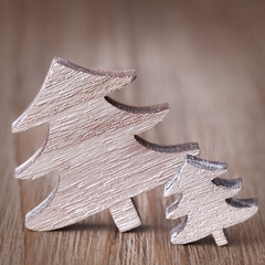 Wooden vintage christmas trees on wooden background