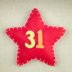 Concept for new year, red star with wooden numbers 31 on vintage
