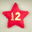 Red star with wooden number 12 on vintage fabric background - 73464722