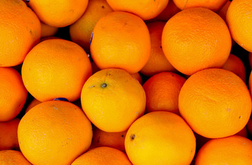 many fresh raw orange background