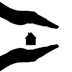Vector silhouette of a hands with house.