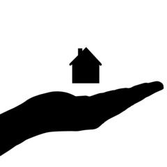 Vector silhouette of a hand with house.