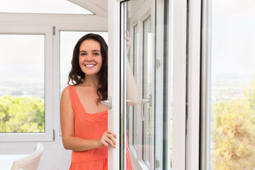 Brunette staying near plastic windows