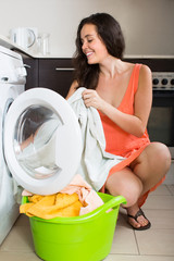 Woman near washing machine