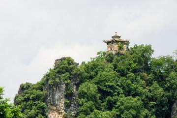 Pavilion on top of limestone peak