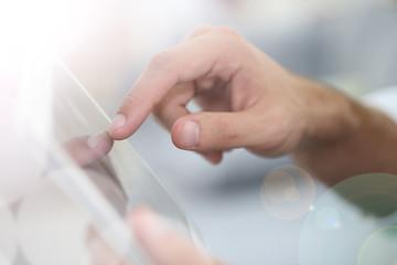 Closeup of hand sliding on digital tablet