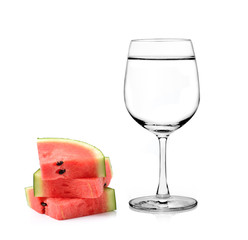Glass of water and watermelon isolated on white background