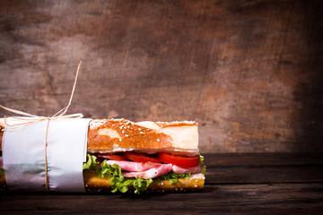 Submarine sandwich on wooden background