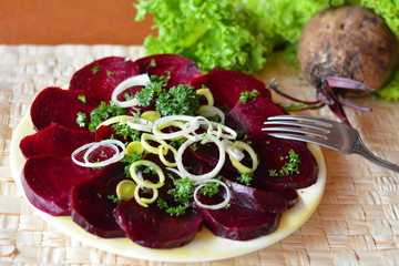 Sliced beetroot salad on the white plate