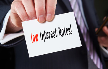 Business card with the words, Low Interest Rates, written on it.