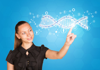 Businesswoman smiling and presses finger on model of DNA