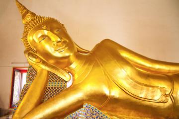 Reclining Buddha gold statue.