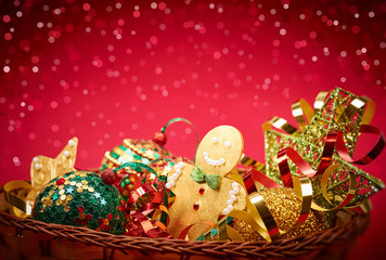 2015 New Year. Christmas decorations in basket on red background