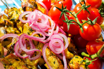 Hot barbecue with cherry tomatoes.