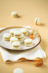 Light Yellow Macarons with Chocolate and Passionfruit Ganache