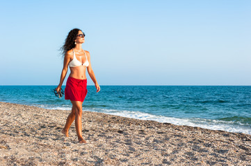 Middle-aged woman walking on the beach