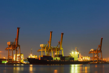 beautiful lighting of freight container comercial ship with ship