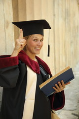 woman graduate with a book