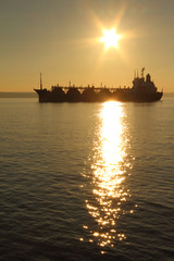 silhouette tanker on sunset background