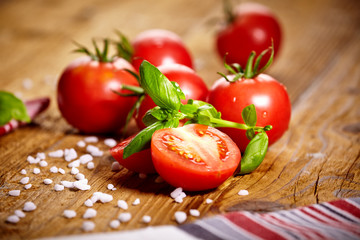 Tomatoes lying on old table. Diet food