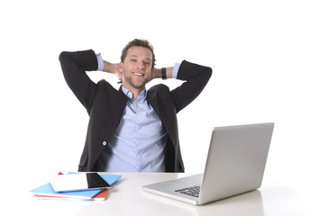 businessman happy at work smiling relaxed at computer