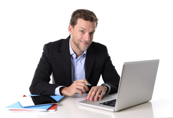 handsome businessman working happy at computer satisfied