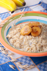 Oat meal with caramelized banana on plate