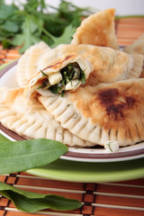 Patties of unleavened dough with greens and cheese