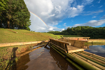 Wooden raft with the clear sky and rainbow