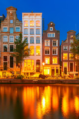 Night city view of Amsterdam canal with dutch houses