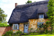 Traditional Old English Cottage with Thatched Roof - 73479798