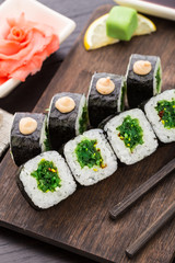 Sushi rolls with chuka salad