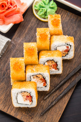 Fried sushi roll with salmon teriyaki