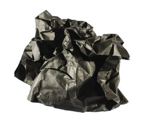 Black crumpled sheet of paper isolated on the white background
