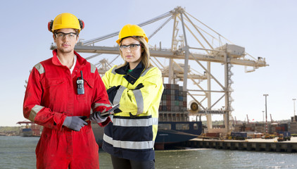 Dockers posing in front of a container ship