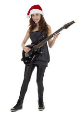Female guitarist with Santa Claus hat
