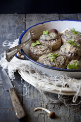 stuffed mushrooms on vintage enamelled tin