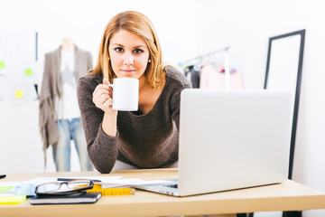 designer working with a laptop at home