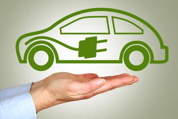Hand holding symbolic electric car