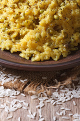 Khichdi on a plate close-up. vertical.