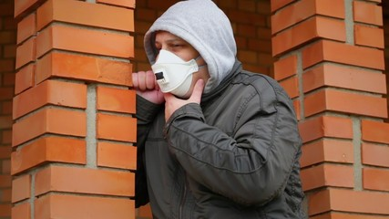 Man in the air mask near building