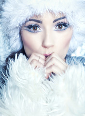 Woman covered with snow flakes.Christmas winter beauty concept