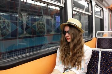 Teen in subway train