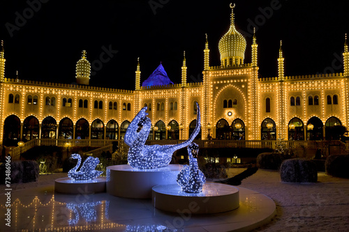 Oriental palace by night in Tivoli Gardens, Copenhagen - 73486966